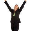 Businesswoman with fists in air looking up